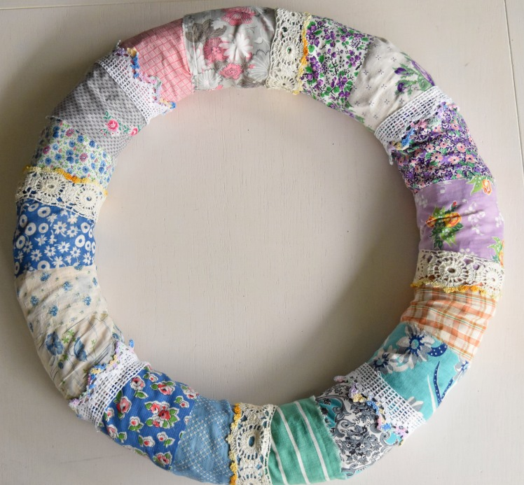 vintage fabric wreath with crocheted pillow edging