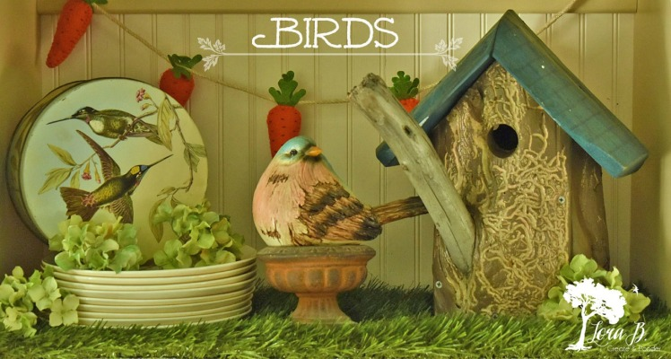 Birdhouse and bird on spring shelf