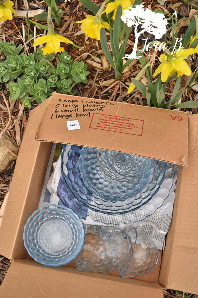 Box of blue bubble vintage dishes.