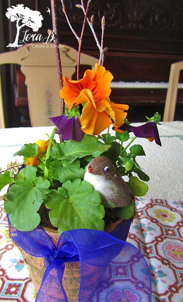 Pansy Pot arrangement with bird.