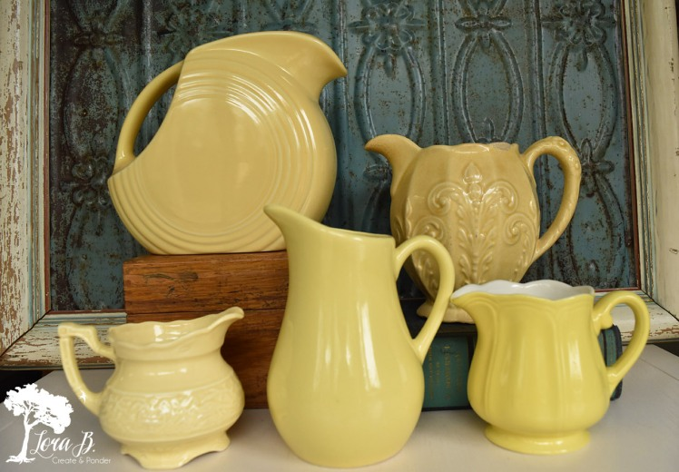 Collection of vintage yellow pitchers.