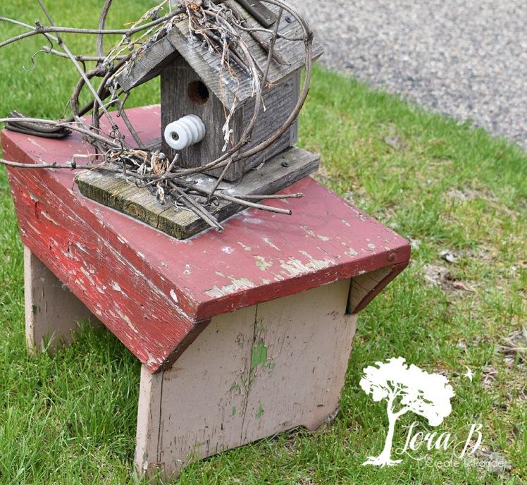 birdhouse on vintage stool