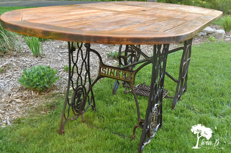 Singer sewing machine base for a table
