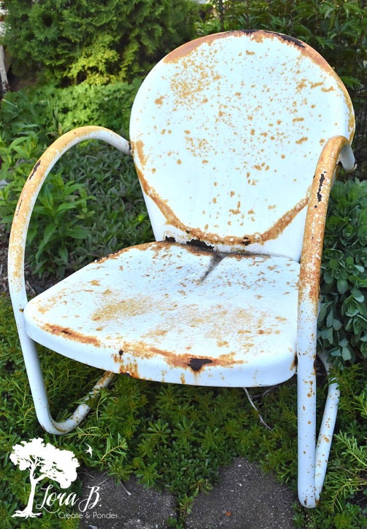 White rusty metal lawn chair