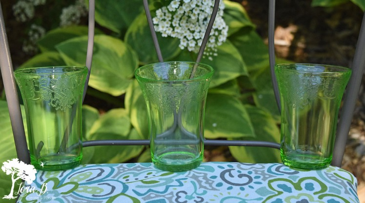 Green depression glass tumblers.