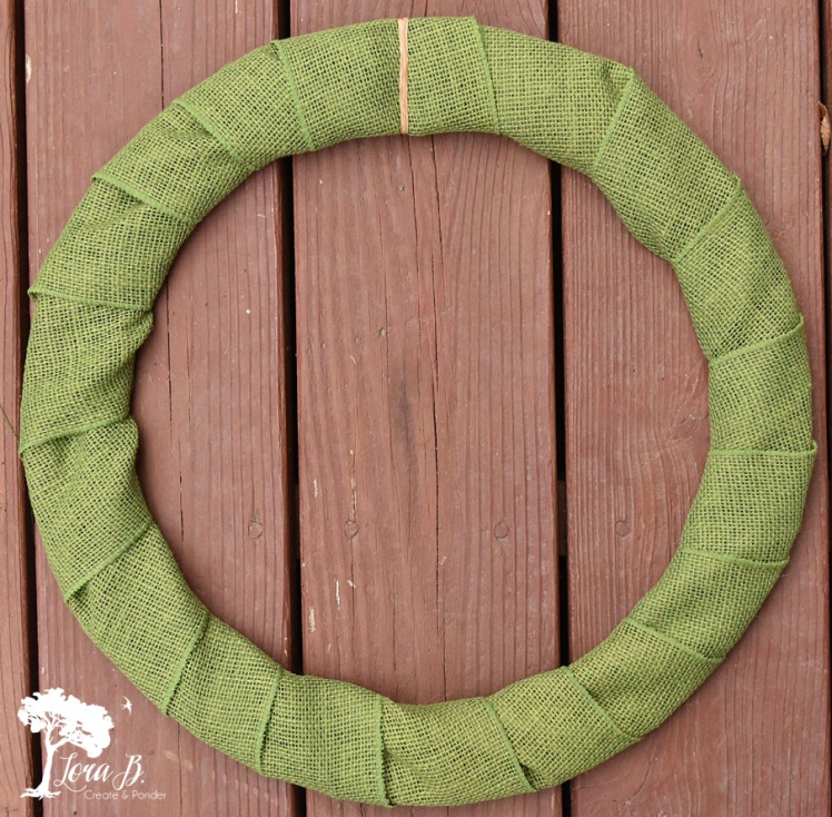 Burlap covered wreath form.