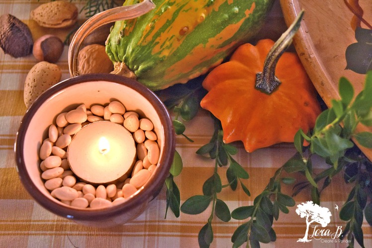 Votive candles in vintage pottery.
