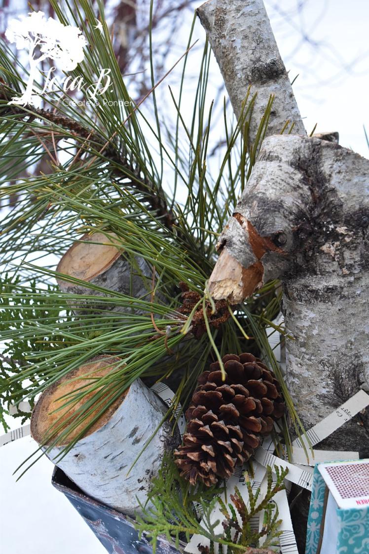 Birch logs in a vintage coal bucket