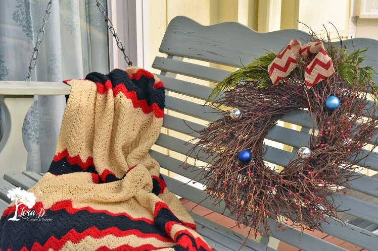 Porch swing, decorated for Christmas